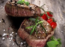 Delicious beef steak on wooden table