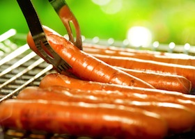 Grilled Sausage on the flaming Grill. BBQ. Bearbeque outdoors. Barbecue Picnic